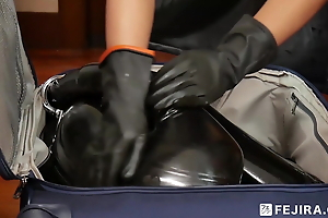 Fejira com – Latex slave girl in make an issue of box