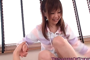Young japanese cutie gets an invasive facial