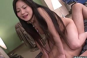 Kinky Japanese babe riding a influenced wang