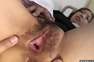 Attractive Japanese gal slurps a big thick meat sandbank