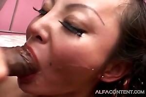A cute Asian girl nigh a brave fight with a handful of guys