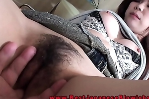 Japanese blowjob babe fingered with regard to her close-fisted pussy