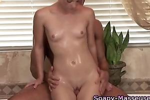 Soapy fetish babe sucks on cock