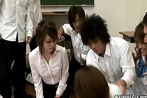 Horny Japanese teacher gets fucked and mistreated