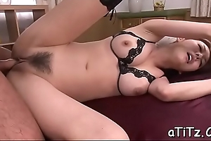 Oriental babe with lovely tits gives magnetizing orall-service