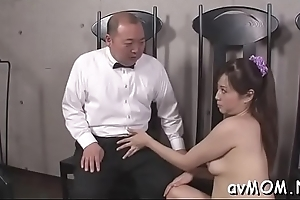 Dirty milf dangles two big schlong and balls on her lips