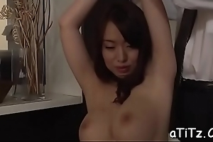 Racy from behind coition for busty oriental