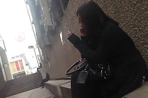 Cute Japanese girl in heels smoking