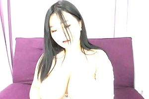 Busty Asian BBW quivers on cam