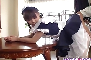 Pretty Asian maid Natsumi exposes hot pussy be fitting of fingering