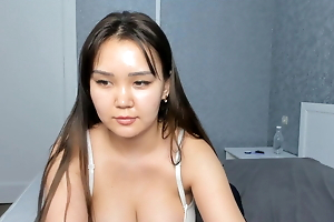 Phat arse Asian demonstrates her naked body increased by masturbates